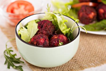 Beetroot falafel served with salad in a bowl