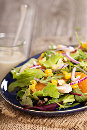 Salad with chicken, corn, oranges and mixed salad Stock Photo