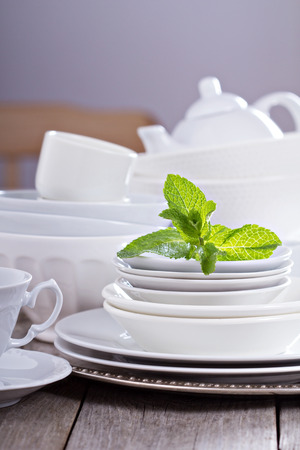 dinnerware: Variety of white dinnerware: plates, cups and bowls
