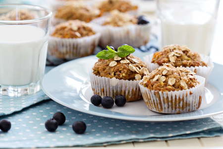 Vegan banana carrot muffins with oats and berries photo