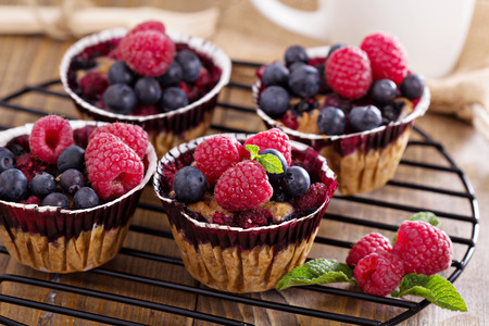 Berry muffin with oats served with fresh berries photo
