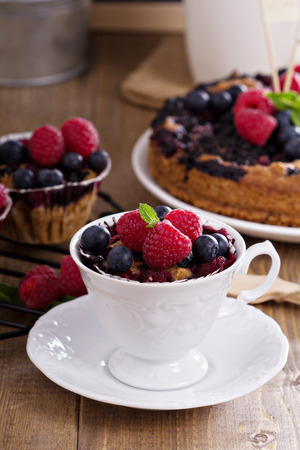Berry muffin with oats served in a cup with fresh berries photo