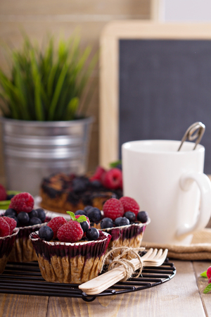 Berry muffins with oats served with fresh berries photo