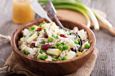 wild rice: Salad with rice, apple, cranberry and peas in a bowl