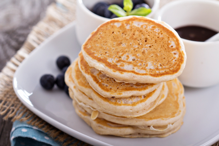 Eggless pancakes for breakfast with blueberries and chocolate sauce photo