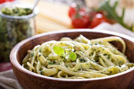 Pasta with arugula walnut pesto in a bowl photo
