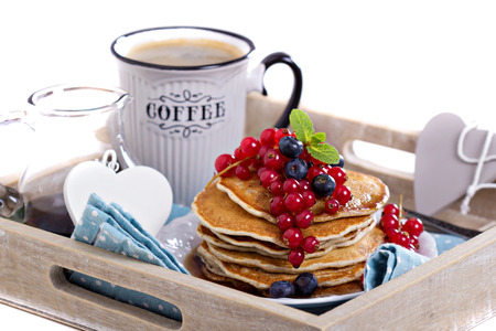 Vegan pancakes with mixed berries for breakfast isolated photo