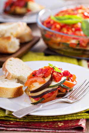 Ratatouille served with bread on a plate photo