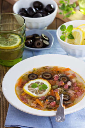 solyanka: Russian soup with meat, sausage and olives Solyanka