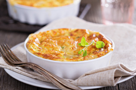 Zucchini and onion bake with eggs and cheese photo