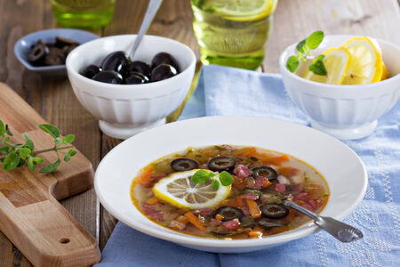 soljanka: Russian soup with meat, sausage and olives Solyanka