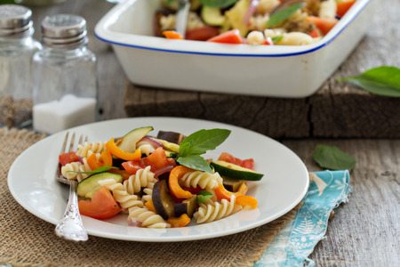 Baked ratatouille pasta with zucchini, eggplant and tomatoes Imagens