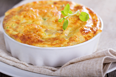 Zucchini and onion bake with eggs and cheese Stock Photo