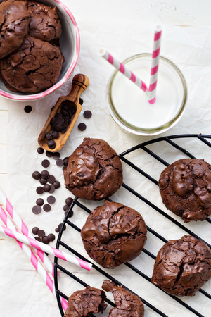 Chocolate meringue cookies in a bowl with choco drops photo