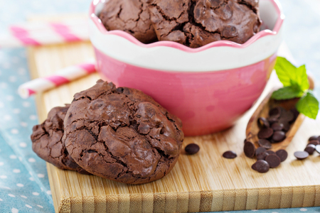 Chocolate meringue cookies in a bowl with choco drops Stock Photo