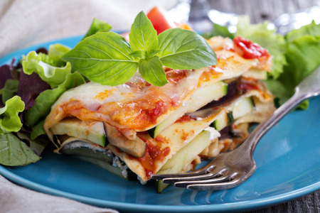 Vegetable lasagna with zucchini, tomato and eggplant Imagens