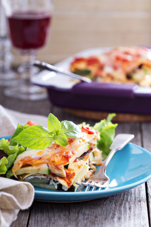 Vegetable lasagna with zucchini, tomato and eggplant Stock Photo