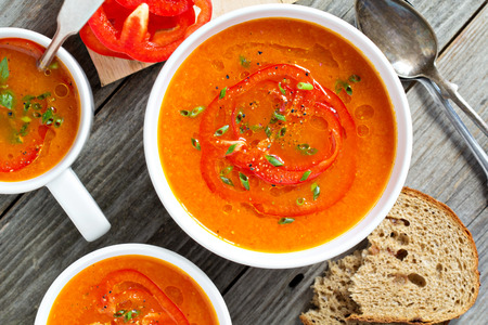 red taste: Roasted red pepper soup in white bowl