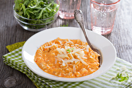 cheesy: Pasta in cheesy roasted bell peppers sauce Stock Photo