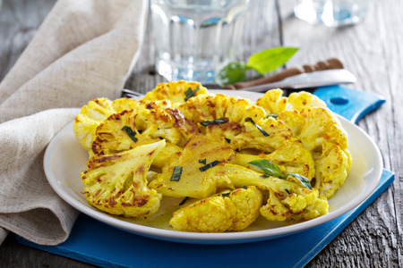 black dish: Grilled cauliflower steaks Stock Photo