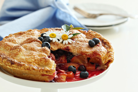 Peach and blueberry summer pie photo