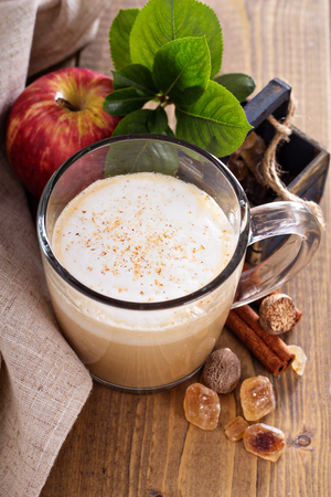 Apple pie latte with cinnamon and syrup photo