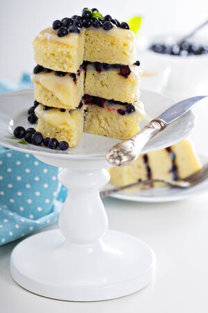 cake stand: Lemon curd blueberry vanilla layer cake on a stand