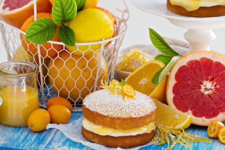 Citrus Victoria Sponge Cake with Lemon Curd and variety of fresh citrus fruits photo