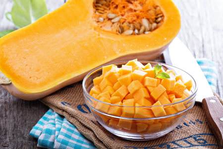 Diced butternut squash in a bowl Stock Photo