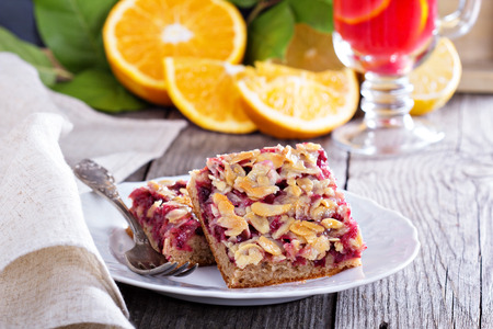 Berry cake bars with caramel almond topping photo