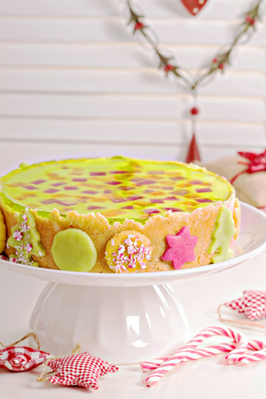 Cheesecake for christmas with colorful jelly photo