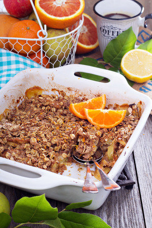 Orange and apple crumble with oats Imagens