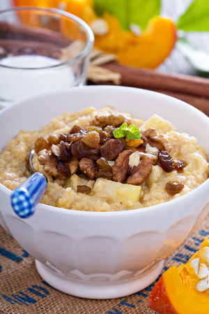 Pumpkin millet porridge with apple and raisins