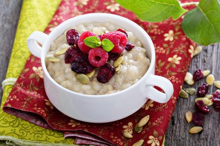 Breakfast multigrain porridge with barley, cornmeal and oats Stock Photo
