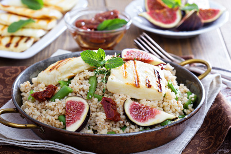 couscous: Spiced cous-cous with green beans, dried tomatoes, fresh figs and cheese