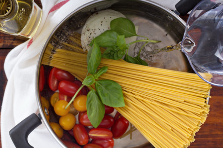Making one pot pasta in progress Stock Photo