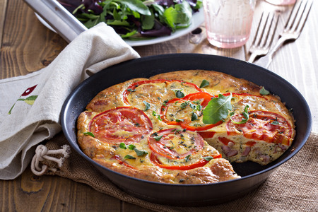 Frittata with vegetables and ham Foto de archivo
