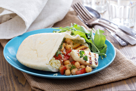 haloumi: Pita bread with couscous and chickpeas Stock Photo