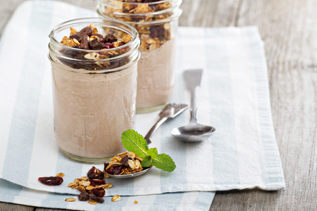 Chocolate smoothie with granola for breakfast 写真素材
