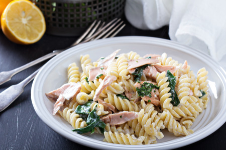 Pasta fusilli with baked salmon and spinach Stock Photo