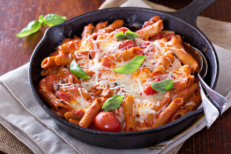 Pasta bake with penne, tomatoes and mozarella