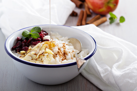 Breakfast rice porridge with almonds and cranberry photo