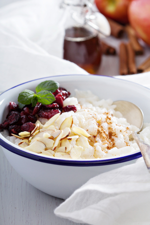 bowl of rice: Breakfast rice porridge with almonds and cranberry Stock Photo