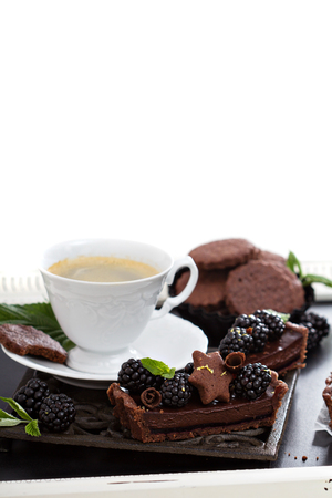 Chocolate blackberry tart with coffee photo