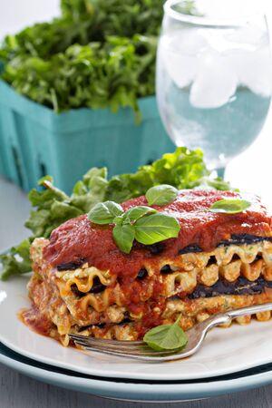 Vegan lasagna with tomato sauce, eggplant and tofu