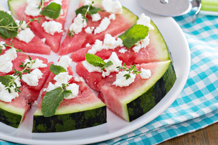cheese knife: Watermelon pizza with feta cheese and herbs