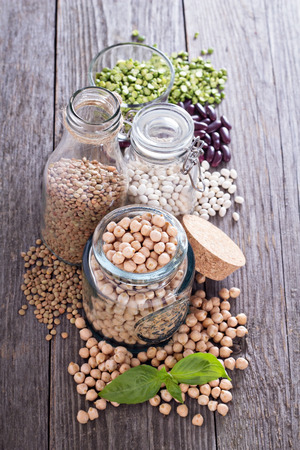 garbanzo bean: Raw beans and lentils in jars Stock Photo