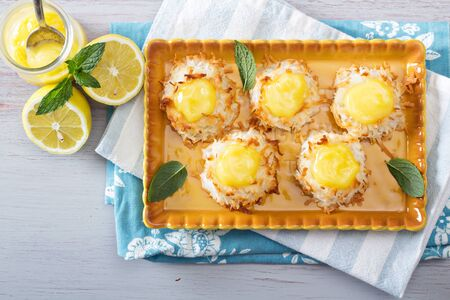 Coconut macaroon cookies filled with lemon curd photo