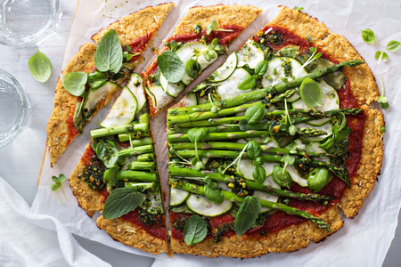 crust: Cauliflower green pizza with spinach, zucchini and asparagus Stock Photo