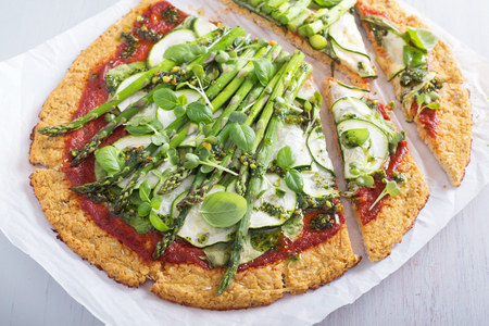 Cauliflower pizza with zucchini and asparagus Stock Photo
